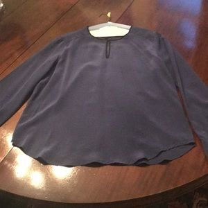 Blue silk top with black trim